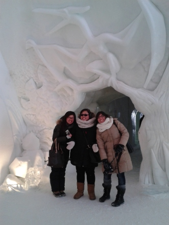 My friends and a carving of a winged creature.